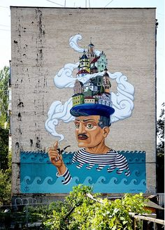 The surrealistic street art by Kislow.  His technique reflects his distintive imagination influenced by surrealist art made by bright colors and fantastic characters.
