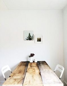white dining space with wood table and minimalist decor. / sfgirlbybay