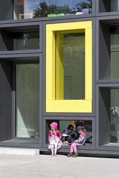Kadawittfeldarchitektur have designed this day care in Hamburg, Germany. The large window facade system offers children a space to play within.
