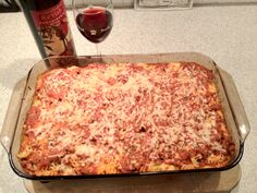 Baked Ziti 1 lb. lean ground beef 1 lb. ziti 1 onion, chopped 2 jars pasta sauce 6 oz.  Provolone, sliced 1 ½ c sour cream 6 oz. mozzarella, sliced 2 tbsp. grated Parmesan  Cook pasta  Brown onion and beef Add pasta sauce and simmer 15 min. Preheat oven to 350, Spray 9 x 13 dish Layer as follows:         ½ ziti         Provolone         Sour cream         ½ sauce mixture         Remaining ziti         Mozzarella         Remaining sauce         Top with parmesan. Bake for 30 min