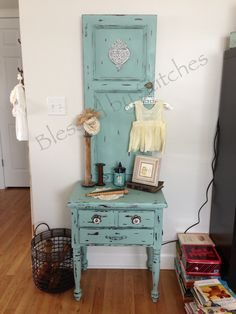 Mini hall tree  made from a end table and cabinet door