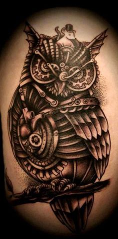 Not only is the work in this owl insane, but he also has a cute little mouse friend. #InkedMagazine #owl #steampunk #tattoo #tattoos #Inked #ink