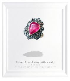 Silver ring with 18 carats gold, and set with a ruby