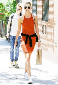 8 Celebrity Outfit Formulas to Try Now via @WhoWhatWear -  Celebrity Style, Karlie Kloss, orange dress, white sneakers