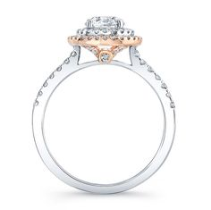 THE CLASSIC DIAMOND HALO IS SOFTENED WITH THE LUMINOUS GLOW OF A SECOND RING CRAFTED IN 18K ROSE GOLD. A TOUCH OF ROSE GOLD CAN BE SEEN IN THE PROFILE, BEZEL SET WITH A SINGLE WHITE DIAMOND. A TOTAL OF 72 WHITE DIAMONDS, AT 0.41CTS., SPARKLE ON THIS ROMANTIC NATALIE K FOR FOREVERMARK® ENGAGEMENT RING SEMI-MOUNT.