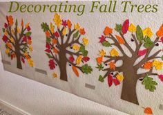 Decorating Fall Trees - a toddler craft using contact paper and leaves!