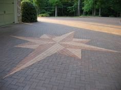 Multi-colored pavers in a varied pattern accented with central star design…