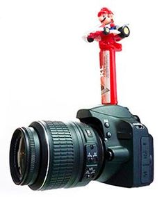 9 Weird Photography Tricks That Actually Work, including this one: Candy dispenser on the hotshoe of a camera.