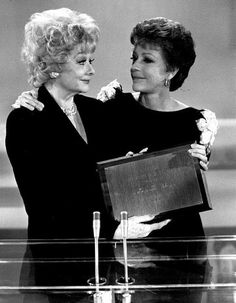 Carol Burnett presents Lucille Ball with TV Guide's Life Achievement Award (1982).
