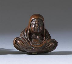 """WOOD NETSUKE By Shumin. In the form of Daruma seated while wrapped in his robes. Signed. Height 1.3"""""""