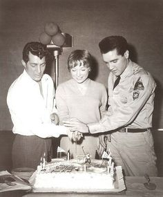 Shirley MacLaine & Elvis Presley join Dean Martin for his birthday.