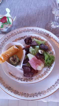 Biltong, Pear, Parmaham & blue cheese salad with a cheese spring roll in fig sauce
