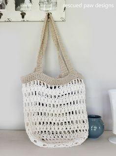Crochet tote bags are always fun to make and our family always seems to get a ton of use from them. I finished this crochet bag earlier this month for my daughter to tote her books back and forth to the beach. I was thrilled the sand fell out the bottom of the bag because of the spaces in the design which meant less mess in my truck and house!