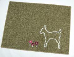 une bien jolie idée pour donner un petit coup de jeune au tapis