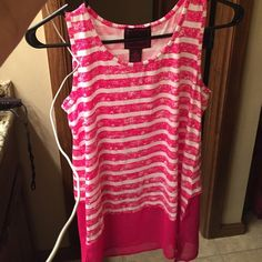 New shirt ! Cute Sm sleeveless top . Brand - even Never heard of even. I was told it was purchased from Nordstrom ... Came to me with tags . I took ten off . It has just hung in the closet. Unworn . Even Tops Tank Tops