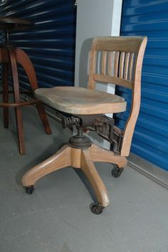 Antique wood chair and stool lot to include a SIKES blonde wood desk chair, antique wood work bench stool, stunning wood stool (Milwaukee chair company 1914) set on adjustable iron swivel base and a small round table.
