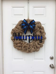 A personal favorite from my Etsy shop https://www.etsy.com/listing/270620236/police-family-name-wreath-leo-wreath