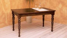 Table 165. Solid toulipier wooden table with lathe-turned legs and a dark-walnut varnished rectangular surface. Tavolo 165. Tavolo in toulipier massello a gambe tornite e piano rettangolare tinto noce scuro.