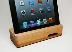 The Ecoustik iPhone/iPad docks merge design, music, woodworking and tech into a single, sustainable, eco-friendly acoustic device that amplifies your tunes while keeping your phone propped up to charge. Designer: Portsmith Co.