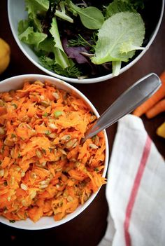 Carrot and Sunflower Seed Salad. A simple fresh and gratifying salad with some crunch. Shredded carrots roasted sunflower seeds and scallions with a lemon honey dressing. Healthy Potluck, Healthy Eating Recipes, Vegetarian Recipes, Cooking Recipes, Snacks Recipes, Healthy Eats, Healthy Foods, Yummy Recipes, Recipies