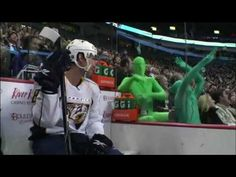 Root Suit fans, green men at hockey game