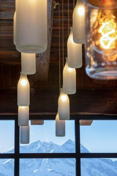These milk bottle pendant light fixtures offer a authentic look to this mountain top restaurant in the French Alps.   Decorative pendant lighting in this dining space.   #milkbottle #milkbottlelighting #pendantlighting #uniquelighting #uniquelights #lightingideas #vintagelighting #vintagelights #rusticlighting #lightingdesign #restaurantdesign #diningdecor #interiordesign #interiorlighting #rusticstyle #vintageinteriors #hanginglights #pendantlights Vintage Pendant Lighting, Contemporary Pendant Lights, Rustic Lighting, Unique Lighting, Interior Lighting, Restaurant Lighting, French Alps, Commercial Lighting, Vintage Interiors