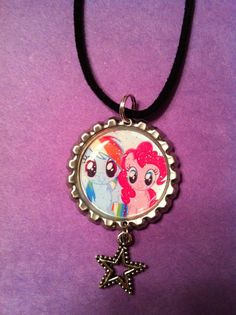 My Little Pony Friendship is Magic Rainbow Dash and Pinkie Pie Bottle Cap Necklace. $4.50, via Etsy.