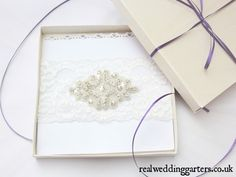 Check out this item in my Etsy shop https://www.etsy.com/uk/listing/248848439/boxed-vintage-ivory-lace-wedding-garter