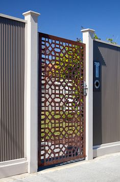 Laser cut steel gate. Great way to make an entrance, maybe for a house with a private courtyard in front?