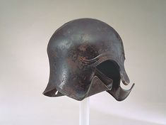 "A Greek Middle/Late Archaic Bronze ""Spoilt"" Corinthian Hel… | Flickr Gladiator Armor, Magna Graecia, Greek Helmet, Corinthian Helmet, Ancient Armor, Warrior Helmet, Greek History, Historical Costume, Bronze Age"