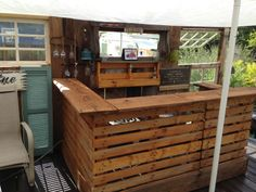 Pallet bar stained with natural oil stain. Also known as Ted's Mahogany Lounge.