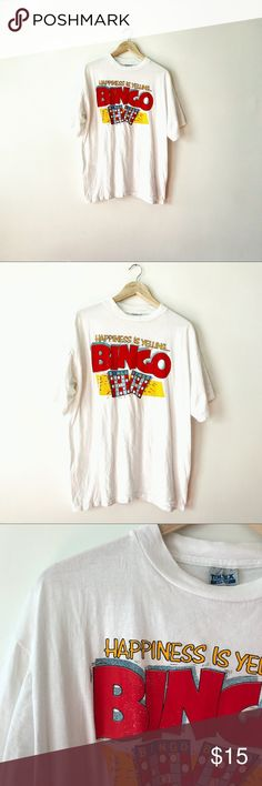 "{vintage} • white ""HAPPINESS IS YELLING BINGO"" tee + + bright white ""HAPPINESS IS YELLING BINGO!"" Funny graphic t-shirt   •• size x-large  •• condition: great — no stains, holes, cracking or discolorations  •• every little ol' lady at the bingo would appreciate this!  — #bingo #bingoaddict #bingohAll #graphictee #graphictshirt #vintagetee #vuntagetshirt #vjntage #vtg Vintage Tops Tees - Short Sleeve"