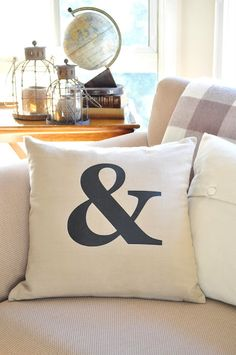 I love the idea of incorporating ampersands wherever possible. Graphic pillows would be simple and easy to transition.