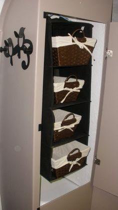 Boler closet storage using a hanging shelf organizer and baskets.