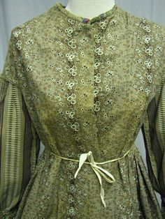 """1860's wool robe - this picture is of the cotton lining.  Bust: 33""""; waist: 25""""; skirt length: 41""""; skirt circumference: 113""""; one hook & eye at neck, green silk tie belt"""