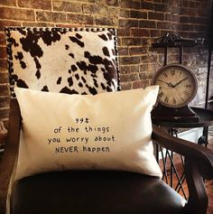 Cowhide, vintage clock, truthful pillow.  Great place to sit!