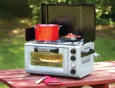 Outdoor Portable Oven & Stove  How cute is this outdoor portable oven and stove? Perfect to keep the heat out of the kitchen for the summer but still able to bake those cookies.   By Coleman, available at gearpatrol.com