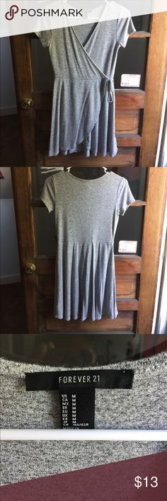 Forever 21 Gray Dress Another dress worn one time and just sitting around. Gray from forever 21. Size M. Flowy and Comfy material.  Long enough in the back for you. Butt looked great and posted a pic of the cleavage just to show you how great they'll look LOL ! Forever 21 Dresses Mini
