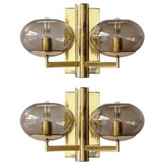 Pair of Double Arm Wall Lights by Gaetano Sciolari | From a unique collection of antique and modern wall lights and sconces at https://www.1stdibs.com/furniture/lighting/sconces-wall-lights/