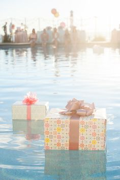 Floating presents at a poolside bridal shower. So cute! Just wrap styrofoam to pull off this gorgeous trick!