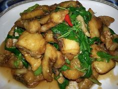 Fried fish with chilly and basil leaft