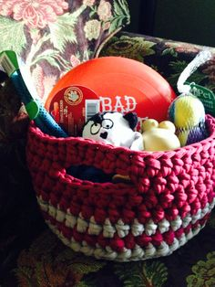 Basket filled with goodies for a new puppy.