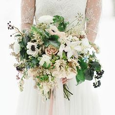 Highlight your winter wedding date with a gorgeous bouquet, bursting with seasonal charm. From crimson red blooms to festive greenery, here are 18 options perfect for your cold-weather nuptials.