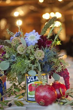 rustic tomato cans, herbs, pomegranates and flowers; rustic Italian wedding theme