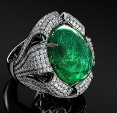 The emerald sample in this ring is very beautiful: bright bluish green colour, harmonic oval form, Zambian origin. The weight is more than 20 ct. Lotus Jewelry, Emerald Jewelry, High Jewelry, Gemstone Jewelry, Gold Jewelry, Jewelry Rings, Jewlery, Unique Rings, Unique Jewelry