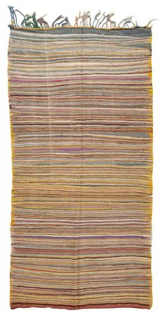 #45441 - Vintage Moroccan Rug, Morocco, Mid 20th Century - Dazzling stripes and multicolored accents embellished with flat-woven hash marks and variegated details create a continuous allover pattern that is paradoxical in its ability to create a high-impact facade that is also well camouflaged. Gradient stripes slowly transition from purples, stormy blues and earth tones to vibrant mustard yellows and saturated carmine…