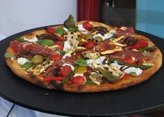 Pizza: $4,200 Chef Domenico Crolla from Glasgow, Scotland was inspired by James Bond when he came up with this pizza concept. The 'Pizza Royale 007' is the most expensive and consists of toppings like champagne-soaked caviar, smoked salmon, lobster marinated in Cognac and 24-karat gold flakes.