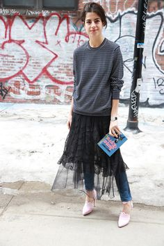Sweater over formal dress (pulled up to make skirt) and skinny jeans | Man Repeller