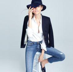Sitting Down Pose. Woman in Menswear. White Linen Shirt. Blazer. Hat. Jeans.