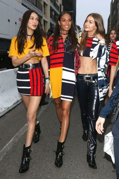 February 8, 2017 Bella Hadid, Joan Smalls and Gigi Hadid wear the new Tommy x Gigi Spring 2017 collection after the runway show in Venice Beach.